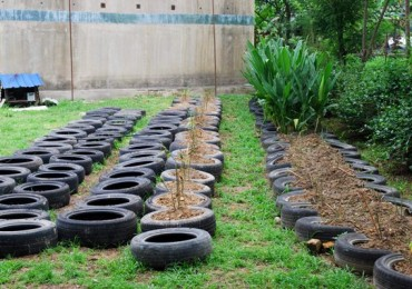 tire gardening, making concrete posts, making drainage holes in tires, uses for old tires,