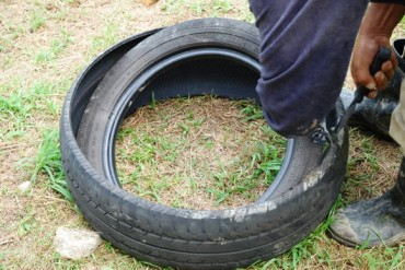 tire gardening,making concrete posts,making drainage holes in tires,uses for old tires
